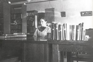 Sparks at the reference desk (date unknown; circa 1916)