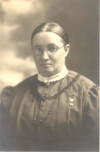 Sparks portrait with glasses (c. 1920s)