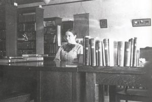 Sparks at the reference desk (smaller copy) 1916?