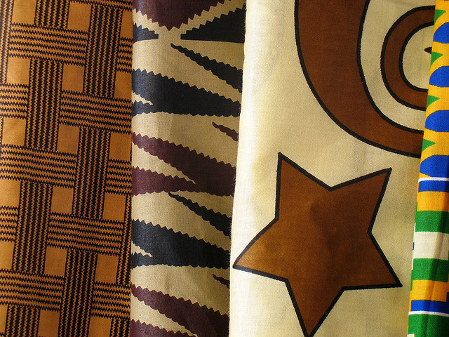 Four patterned African textiles on display