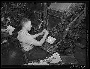 Linotype operator on the Chicago Defender, Negro newspaper. Chicago, Illinois