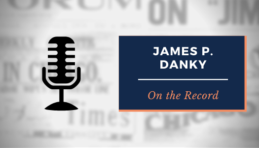 "Graphic: Microphone icon, next to text: ""James P. Danky: On the Record."" Faded newspaper titles wallpaper background."
