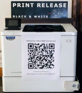 image of printer with QR code and web information