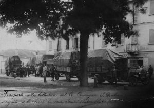A black and white image of a series of trucks transporting the Cavagna Sanguiliani Collection