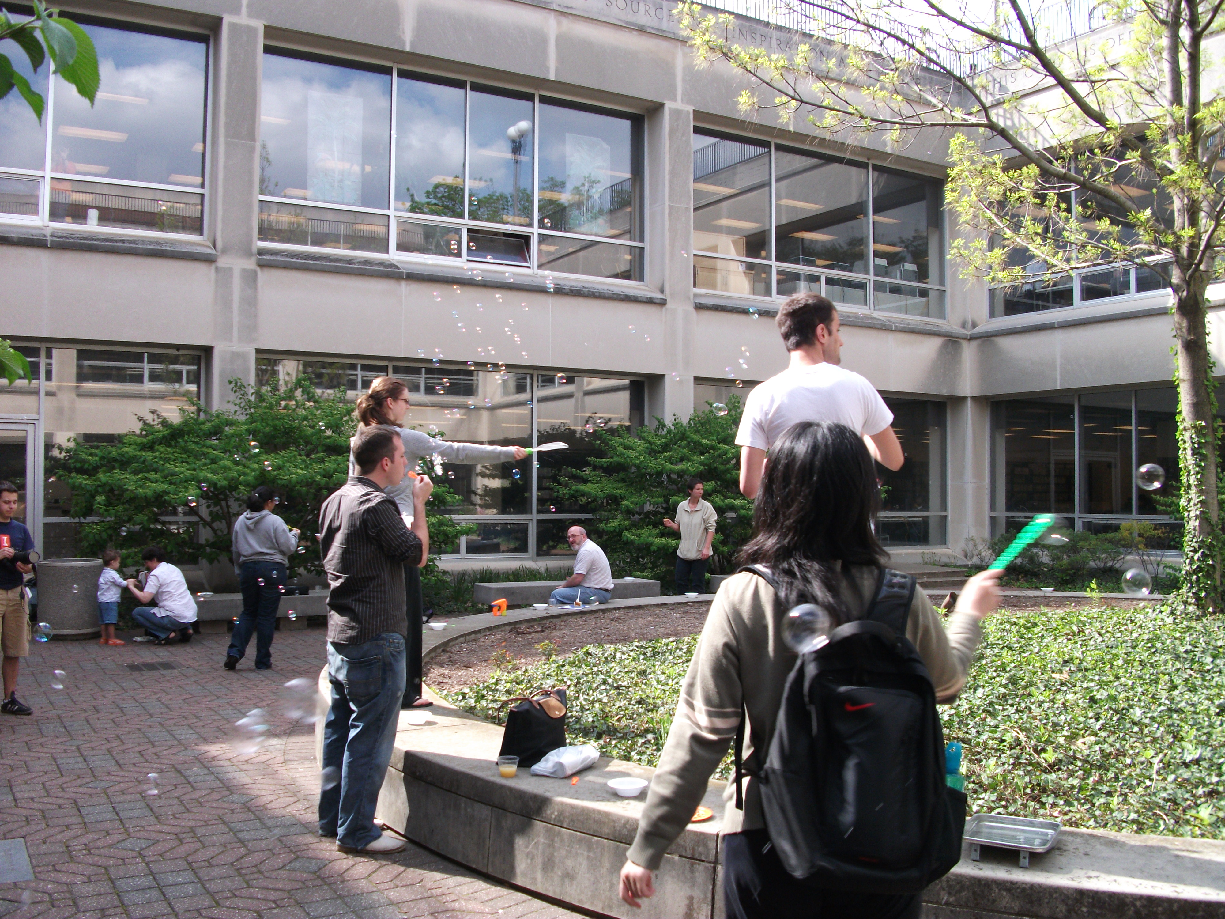 Blowing bubbles in UGL coutyard photo