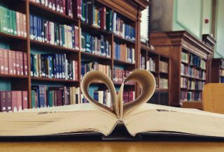 Open book with pages forming heart