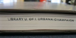 Book with Library U of I Urbana-Champaign on pages