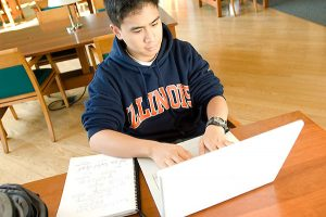 male student working on a computer at the University of Illinois at Urbana-Champaign